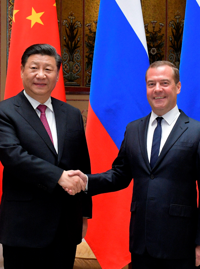 Kinas president Xi Jinping og russlands statsminister Dmitry Mededev			Alexander Astafyev, Sputnik, Government Pool Photo via A